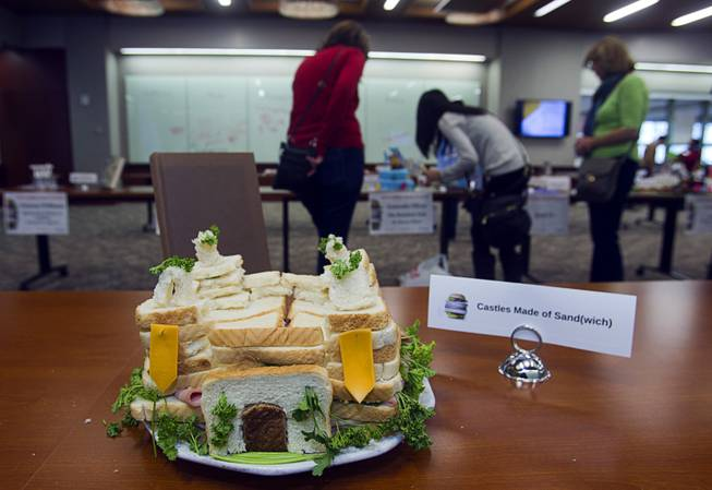 """Castles Made of Sand(wich) by Alyssa Maher and Aaron Janushan is displayed during the 2014 Edible Book Festival at the UNLV Lied Library Tuesday, April 1, 2014. Students were challenged to create edible creations inspired by books."