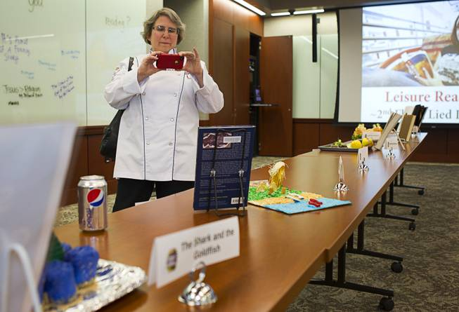 Jean Hertzman, an associate professor in the hotel college, takes a photo of an entry during the 2014 Edible Book Festival at the UNLV Lied Library Tuesday, April 1, 2014. Students were challenged to create edible creations inspired by books.