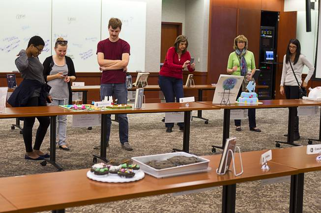 Students look over entries during the 2014 Edible Book Festival at the UNLV Lied Library Tuesday, April 1, 2014. Students were challenged to create edible creations inspired by books.