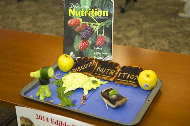 "A creation by Jose Romo is displayed during the 2014 Edible Book Festival at the UNLV Lied Library Tuesday, April 1, 2014. The work is inspired by ""Discovering Nutrition,"" a textbook by Paul Insel and others. The work won for the Best Entry Food-related or Cookbook Category."