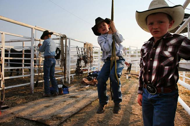 Young cowboys prepare to compete in the annual rodeo in the rural town of Deer Trail, Colo., on Aug. 16, 2013.