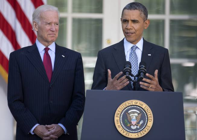 President Barack Obama, with Vice President Joe Biden, speaks in the Rose Garden of the White House in Washington, Tuesday, April 1, 2014, about the Affordable Care Act.