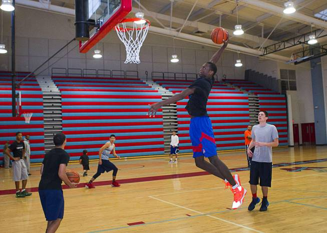 Nate Grimes, a member of the Las Vegas Knicks, attempts a dunk during practice at Western High School Wednesday, April 2, 2014. The club team has gone from starting its program to being nationally ranked in three years. Now they have a sponsorship from Reebok.