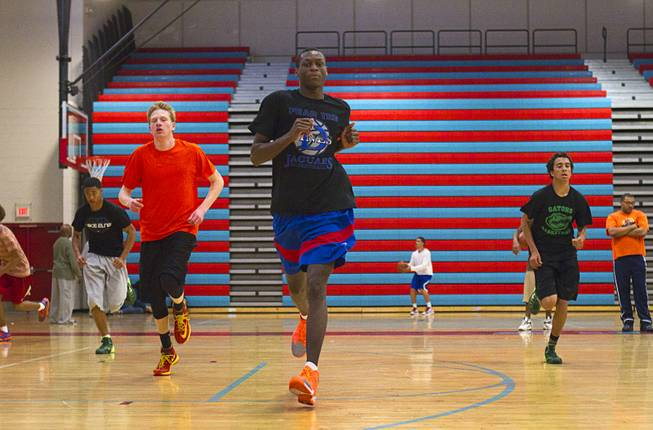 Nate Grimes, center, and other members of the Las Vegas Knicks, runs during practice at Western High School Wednesday, April 2, 2014. The club team has gone from starting its program to being nationally ranked in three years. Now they have a sponsorship from Reebok.
