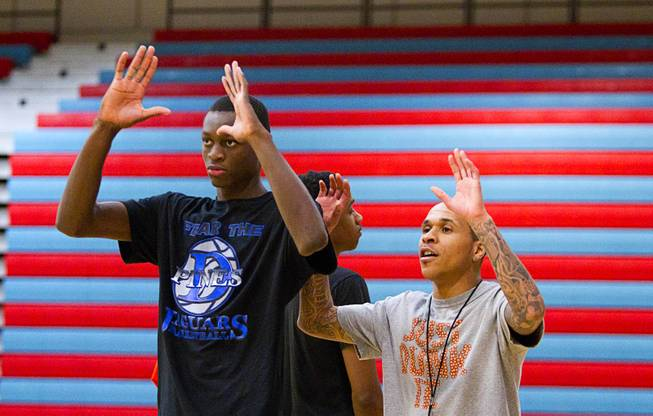 Nate Grimes, left, follows instruction from assistant coach and former Bishop Gorman player Dinard Taylor during Las Vegas Knicks practice at Western High School Wednesday, April 2, 2014. The club team has gone from starting its program to being nationally ranked in three years. Now they have a sponsorship from Reebok.