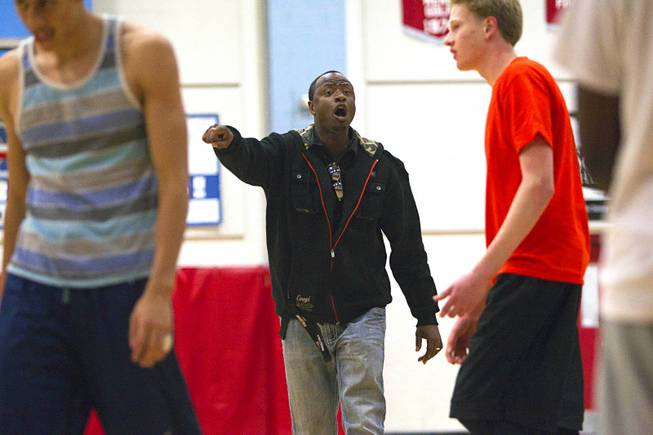 Las Vegas Knicks coach Lamar Bigby instructs players during practice at Western High School on Wednesday, April 2, 2014. The club team has gone from starting its program to being nationally ranked in three years. Now it has sponsorship from Reebok.
