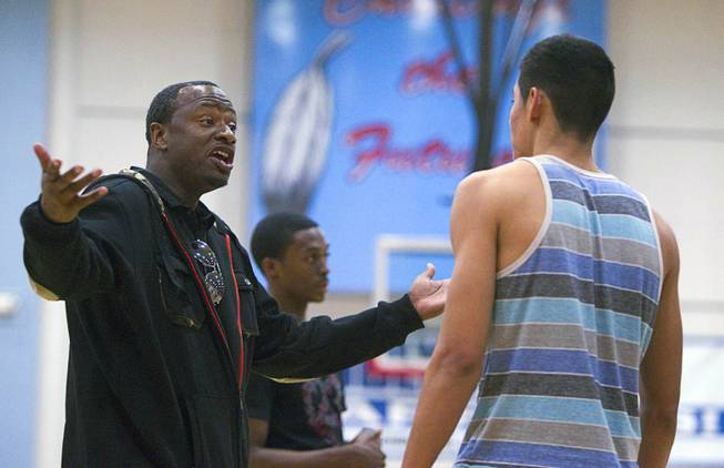 Las Vegas Knicks coach Lamar Bigby gives instruction to Ulises Santillan during practice at Western High School Wednesday, April 2, 2014. The club team has gone from starting its program to being nationally ranked in three years. Now they have a sponsorship from Reebok.