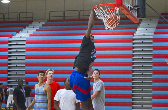 Nate Grimes dunks during Las Vegas Knicks practice at Western High School Wednesday, April 2, 2014. The club team has gone from starting its program to being nationally ranked in three years. Now they have a sponsorship from Reebok.