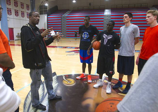 Las Vegas Knicks coach Lamar Bigby talks with players after practice at Western High School Wednesday, April 2, 2014. The club team has gone from starting its program to being nationally ranked in three years. Now they have a sponsorship from Reebok.