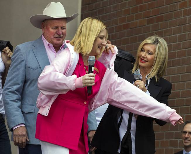 "Olivia Newton-John presents Eileen Moore, Regional President of the Flamingo Las Vegas, with a her very own ""Pink Ladies"" jacket on Wednesday, April 2, 2014."