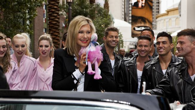 Olivia Newton-John makes her official Las Vegas arrival from the back of a restored T-Bird with a welcome event along the Linq at the Flamingo on Wednesday, April 2, 2014.