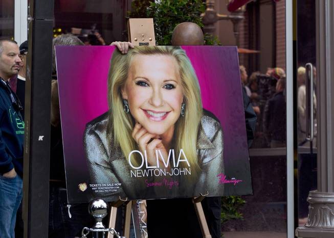 Olivia Newton-John signage marking her official Las Vegas arrival with a welcome event along the Linq at the Flamingo on Wednesday, April 2, 2014.