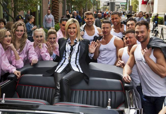 "Olivia Newton-John makes her official Las Vegas arrival with a welcome event Wednesday, April 2, 2014, at the Linq. Pictured with Newton-John: ""Jubilee"" at Bally's showgirls and Chippendales at the Rio stars Jaymes Vaughan, Ryan Stuart, Matt Marshall, Jon Howes, Nathan Minor and James Davis."