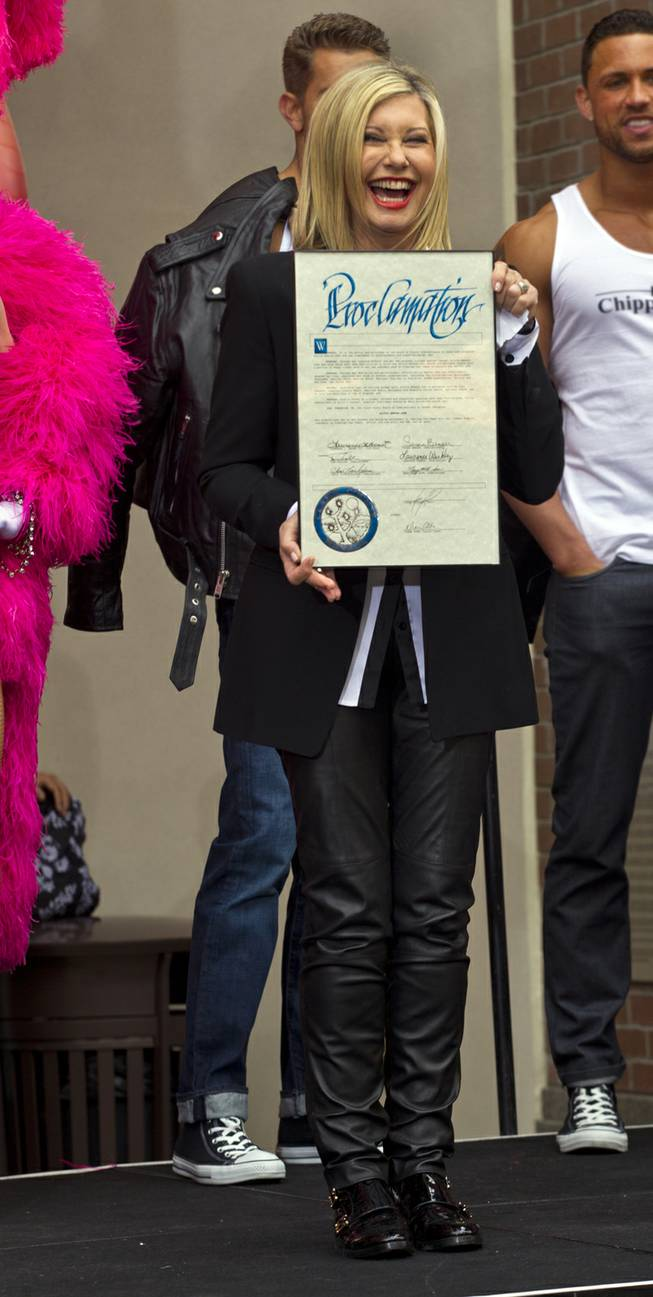 Olivia Newton-John shows off her proclamation as she makes her official Las Vegas arrival to begin her residency Summer Nights at the Flamingo on Wednesday, April 2, 2014.