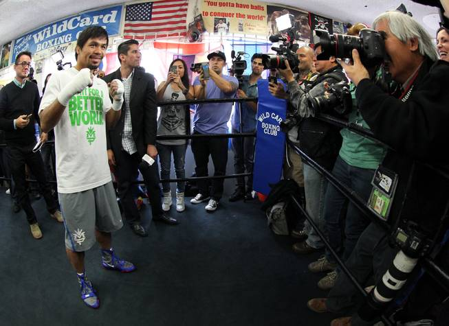 Manny Pacquiao poses for photographers during media day at the Wild Card Boxing Club in Hollywood, Calif. Wednesday, April 2, 2014 for his eagerly-anticipated rematch against undefeated WBO World Welterweight  champion Timothy Bradley.