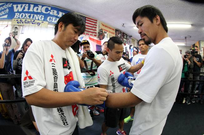 Manny Pacquiao works out during media day at the Wild Card Boxing Club in Hollywood, Calif. Wednesday, April 2, 2014 for his eagerly-anticipated rematch against undefeated WBO World Welterweight  champion Timothy Bradley.