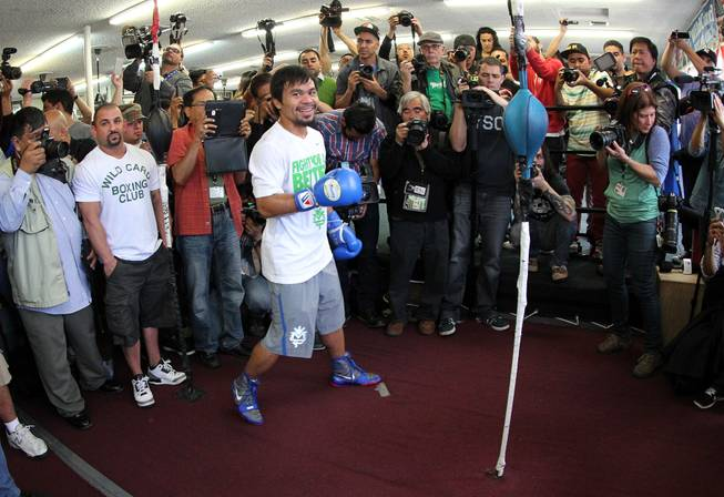 Manny Pacquiao works out during media day at the Wild Card Boxing Club in Hollywood, Calif. Wednesday, April 2, 2014 for his eagerly-anticipated rematch against undefeated WBO World Welterweight  champion Timothy Bradley.  .
