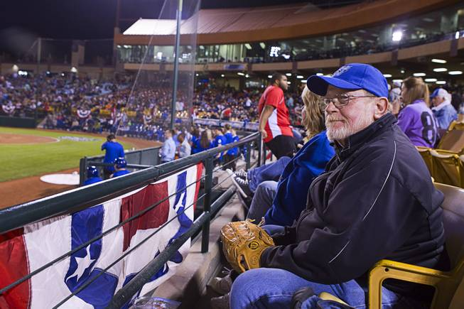 John Heise is ready for a foul ball during the 51's season opener against the Fresno Grizzlies Thursday, April 3, 2014.