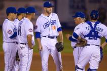 Las Vegas 51s manager Wally Backman, second from right, talks with players during the 51s' season opener Thursday, April 3, 2014, against the Fresno Grizzlies.