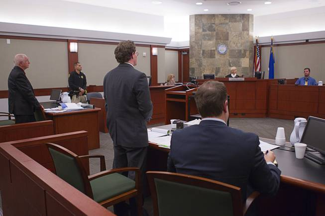 John Michael Schaefer, left, a candidate for Nevada state controller, listens as Kevin Benson, senior deputy attorney general, questions his son Michael Schaefer during a hearing at the Regional Justice Center Thursday, April 3, 2014. Scott Gilles, Nevada's chief elections deputy, sits at right. Election officials want the court to remove Schaefer from the Democratic primary ballot because they contend he doesn't meet residency requirements.
