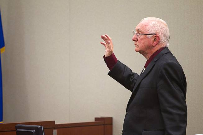 John Michael Schaefer, a candidate for Nevada state controller, takes an oath before testifying on his own behalf during a hearing at the Regional Justice Center Thursday, April 3, 2014. Election officials want the court to remove Schaefer from the Democratic primary ballot because they contend he doesn't meet residency requirements.