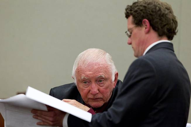 John Michael Schaefer, a candidate for Nevada state controller, looks at documents held by Kevin Benson, senior deputy attorney general, during a hearing at the Regional Justice Center Thursday, April 3, 2014. Election officials want the court to remove Schaefer from the Democratic primary ballot because they contend he doesn't meet residency requirements.