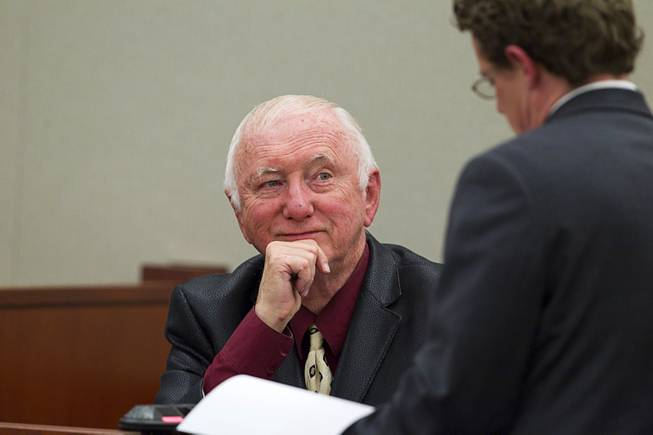 John Michael Schaefer, a candidate for Nevada state controller, looks at Kevin Benson, senior deputy attorney general, during a hearing at the Regional Justice Center Thursday, April 3, 2014. Election officials want the court to remove Schaefer from the Democratic primary ballot because they contend he doesn't meet residency requirements.
