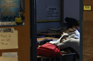 A student rests his head on a desk during first period at Cheyenne High School Thursday, April 3, 2014.