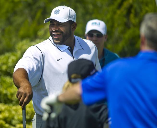Former NFL player Jerome Bettis laughs with teammates during opening day play of the Michael Jordan Celebrity Invitational at Shadow Creek Golf Course on Thursday, April 3, 2014.