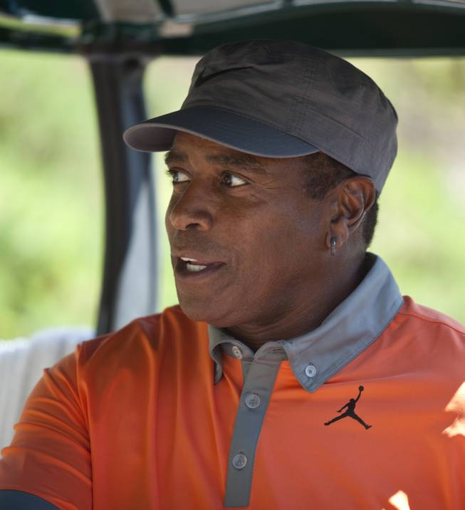 Former NFL player Ahmad Rashad talks about his score during opening day play of the Michael Jordan Celebrity Invitational at Shadow Creek Golf Course on Thursday, April 3, 2014.