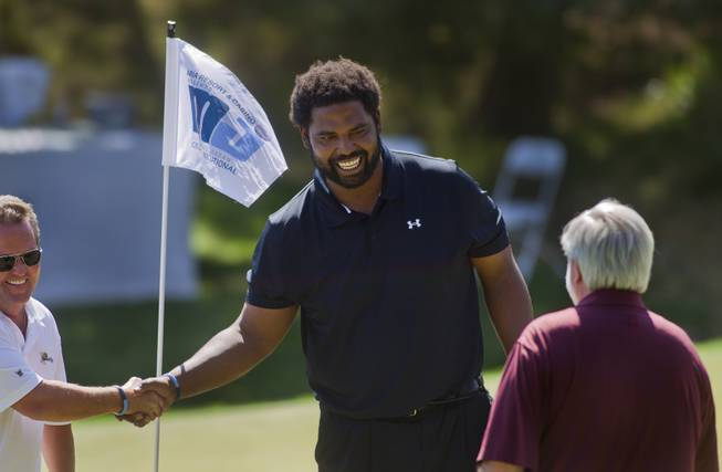 Former NFL player Jonathan Ogden thanks his teammates during opening day play of the Michael Jordan Celebrity Invitational at Shadow Creek Golf Course on Thursday, April 3, 2014.