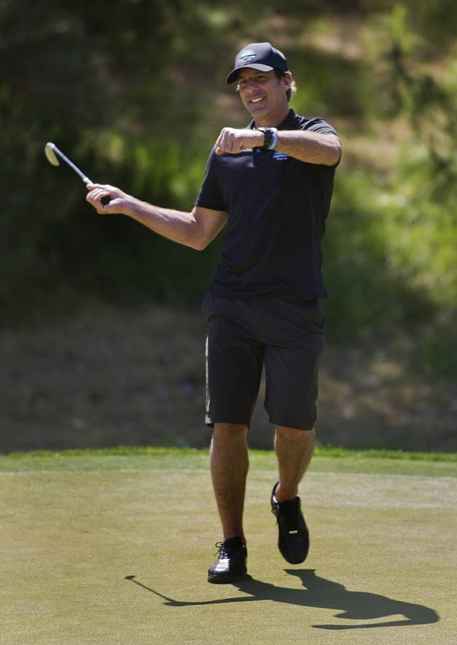 Former NHL player Chris Chelios reacts to a near miss during opening day play of the Michael Jordan Celebrity Invitational at Shadow Creek Golf Course on Thursday, April 3, 2014.