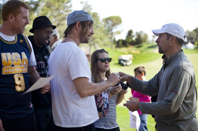 Former MLB player John Smoltz signs autographs for fans during opening day play of the Michael Jordan Celebrity Invitational at Shadow Creek Golf Course on Thursday, April 3, 2014.
