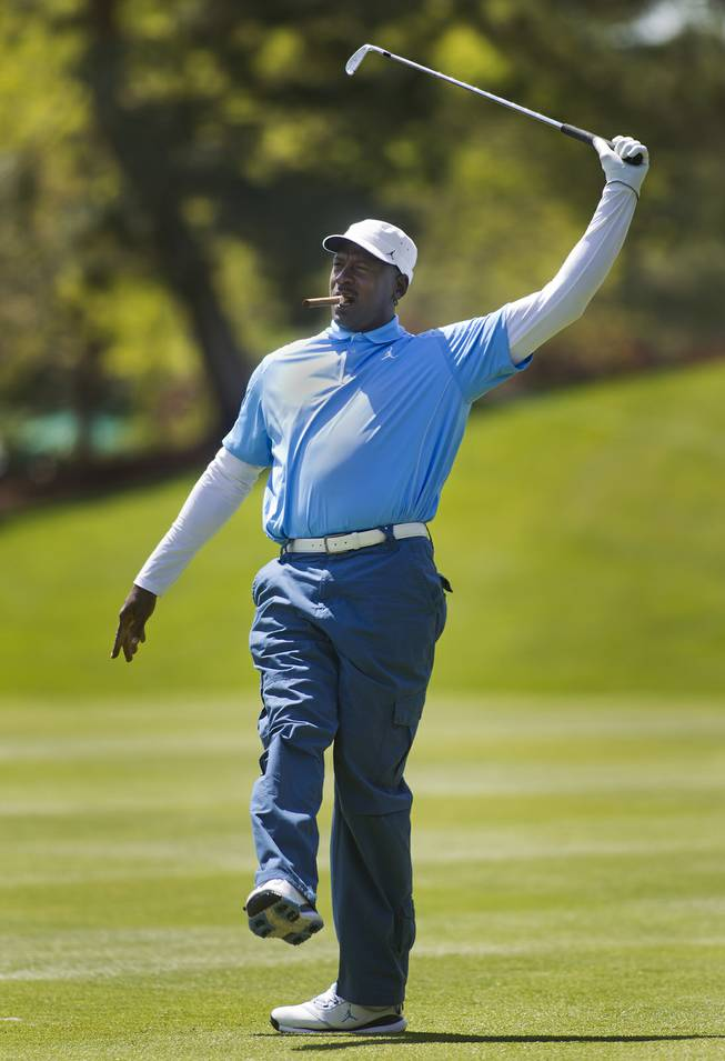 Former NBA star Michael Jordan reacts to a shot during opening day play of the Michael Jordan Celebrity Invitational at Shadow Creek Golf Course on Thursday, April 3, 2014.