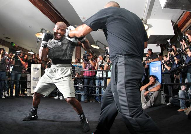 Undefeated WBO World Welterweight champion Timothy Bradley hits the mitts with trainer Joel Diaz during media day during media day Thursday, April 3, 2014 at Fortune Gym in Hollywood, Calif. for his eagerly-anticipated rematch against superstar Manny Pacquiao.