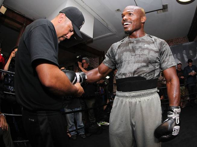 Undefeated WBO World Welterweight champion Timothy Bradley gets his gloves laced by trainer Joel Diaz during media day during media day Thursday, April 3, 2014 at Fortune Gym in Hollywood,Ca. for his eagerly-anticipated rematch against superstar Manny Pacquiao.