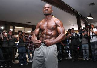 Undefeated WBO World Welterweight champion Timothy Bradley flexes during media day during media day Thursday, April 3, 2014 at Fortune Gym in Hollywood, Calif. for his eagerly-anticipated rematch against superstar Manny Pacquiao.