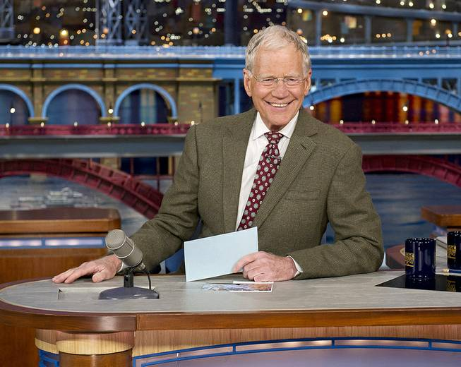 "David Letterman, host of the ""Late Show with David Letterman,"" is seated at his desk in New York on Thursday, April 3, 2014. During taping of the Thursday night telecast, Letterman announced that he will retire in 2015 when his contract expires."