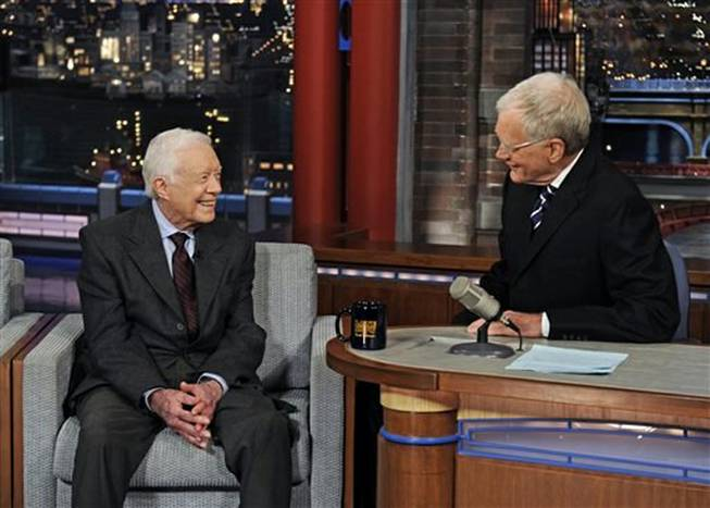 "Former President Jimmy Carter, left, talks with David Letterman on ""Late Show with David Letterman,"" Monday March 24, 2014. During a taping of the show Thursday, April 3, 2014, Letterman said he has informed his CBS bosses that he will step down in 2015, when his current contract expires."