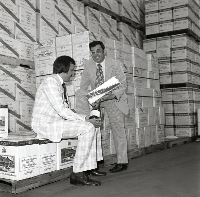 Larry Ruvo, left, and Jerry Vallen look over a bottle of wine at the Southern Wine & Spirits warehouse for the first ever UNLVino event in that took place in 1974.