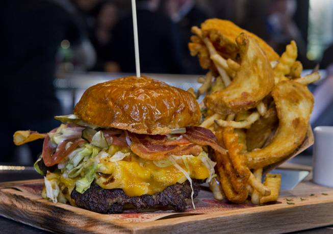The Mac & Cheese Bacon Burger on the menu at Guy Fieri's Vegas Kitchen & Bar set to open later this month on Friday, April 4, 2014.