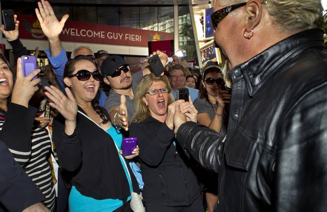 Guy Fieri greets his fans at The Quad as he arrives to introduce his first Las Vegas restaurant Guy Fieri's Vegas Kitchen & Bar on Friday, April 4, 2014.