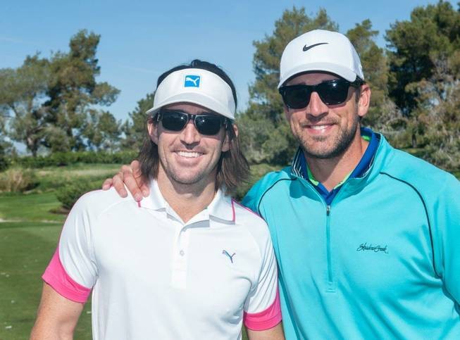 Jake Owen and Aaron Rodgers on opening day of the 2014 Michael Jordan Celebrity Invitational pro-am golf tournament Thursday, April 3, 2014, at Shadow Creek Golf Course.