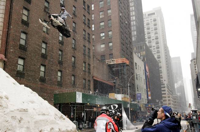 "Snowmobile rider Jay Quinlan, 25, rehearses a jump he is performing later Monday for the ""Late Show with David Letterman"" television show onto a mound of snow on a New York street on Feb 28, 2005. Quinlan will be riding in Outdoor Life Network's Winter Gravity Games which will be airing on OLN starting March 27, 2005."