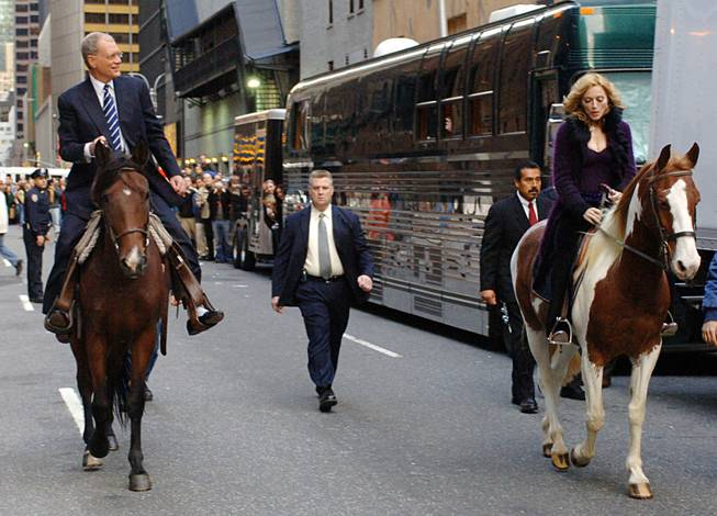 In this photo released by CBS, Madonna and David Letterman ride horses on New York's West 53rd Street when the music superstar appeared on The Late Show with David Letterman, Thursday, Oct. 20, 2005. This is Madonnas first visit to the Late Show since Nov. 11, 2003.