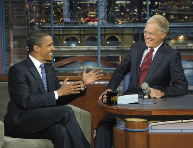 "In this photo released by CBS, Democratic presidential candidate Sen. Barack Obama, D-Ill., left, talks with host David Letterman on the set of ""The Late Show With David Letterman,"" Wednesday, Sept. 10, 2008. It was Obama's fifth visit to the show. When John McCain decided to cast Barack Obama as feckless upstart, an empty suit, he reached for the dirtiest word he could use: ""celebrity."""