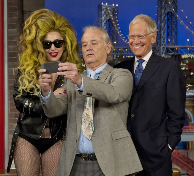 "Bill Murray, center, takes a selfie with Lady Gaga and David Letterman during ""The Late Show With David Letterman"" on Wednesday, April 2, 2014, in New York. The singer had Murray, Letterman and the entire audience over to the Roseland Ballroom for her performance."