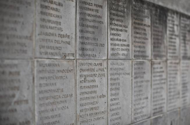 The names of some of those who were slaughtered as they sought refuge inside the church are inscribed on a stone memorial outside to the thousands who were killed in and around the Catholic church during the 1994 genocide in Ntarama, Rwanda, Friday, April 4, 2014.