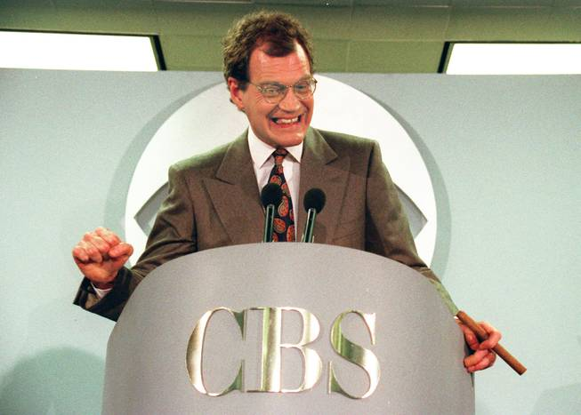 "This Jan. 15, 1993 file photo shows talk-show host David Letterman announces his new contract with CBS television for his new show ""The Late Show with David Letterman,"" in New York.  Letterman announced his retirement during a taping on Thursday, April 3, 2014. Although no specific date was announced he told the audience that he will leave his desk sometime in 2015."