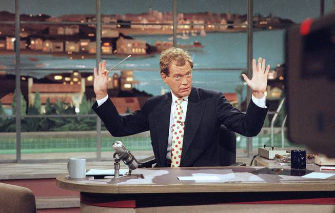"This May 9, 1994 file photo released by CBS shows David Letterman gesturing during a week-long taping of the ""Late Show with David Letterman,"" in Los Angeles.  Letterman announced his retirement during a taping on Thursday, April 3, 2014. Although no specific date was announced he told the audience that he will leave his desk sometime in 2015."